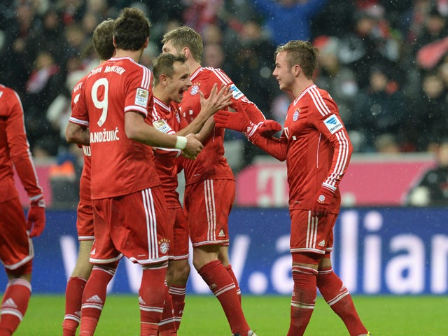Bayern Munich's Croatian striker Mario Mandzukic, Bayern Munich's striker Thomas Muller, Bayern Munich's Brazil defender Rafinha, Bayern Munich's midfielder Toni Kroos and Bayern Munich's midfielder Mario Goetze celebrate the second goal during the German