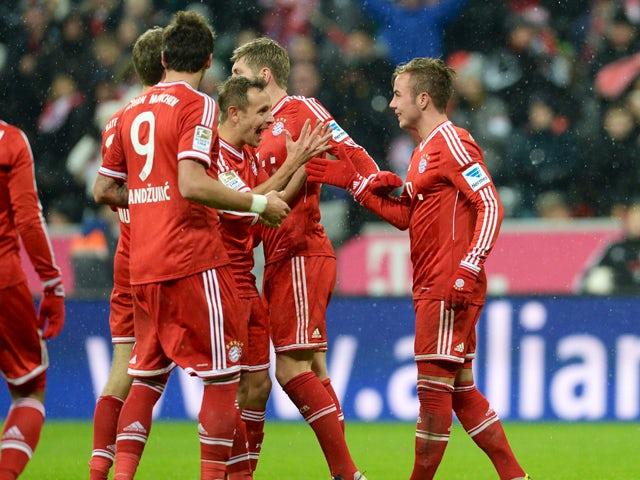 Bayern Munich's Croatian striker Mario Mandzukic, Bayern Munich's striker Thomas Muller, Bayern Munich's Brazil defender Rafinha, Bayern Munich's midfielder Toni Kroos and Bayern Munich's midfielder Mario Goetze celebrate the second goal during the German