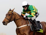 Tony McCoy and Binocular clear the last flight before landing The toteplacepot Contenders Hurdle Race run at sandown Park Racecourse on February 6, 2010