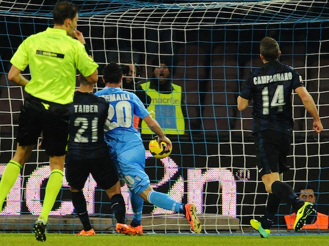 Blerim Dzemaili of Napoli scores his team's third goal during the Serie A match between SSC Napoli vs FC Internazionale Milano at Stadio San Paolo on December 15, 2013