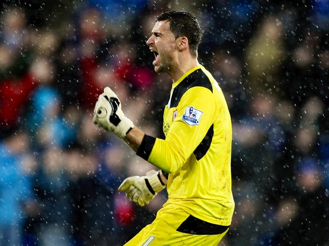 David Marshall of Cardiff celebrates after Peter Whittingham scores his team's opening goal of the game during the Premier League match between Cardiff City and West Bromwich Albion at Cardiff City Stadium on December 14, 2013