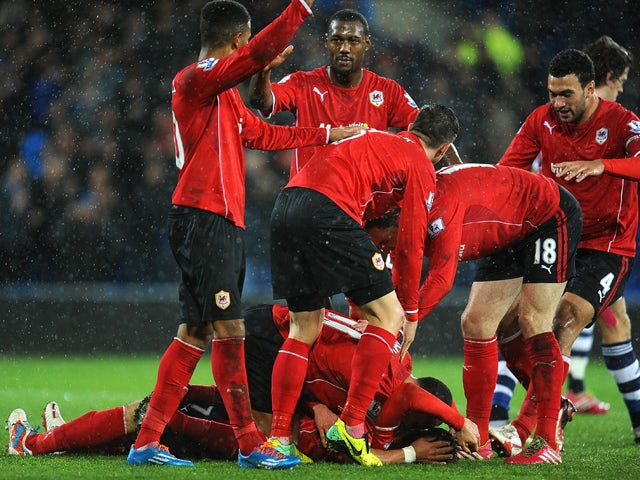 Peter Whittingham #7 of Cardiff City is congratulated by team-mates after scoring the opening goal during the Barclays Premier League match between Cardiff City and West Bromwich Albion at Cardiff City Stadium on December 14, 2013