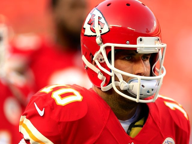 Quarterback Chase Daniel of the Kansas City Chiefs warms up prior to the preseason game against the Green Bay Packers at Arrowhead Stadium on August 29, 2013