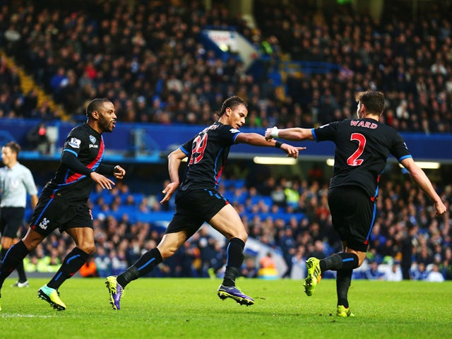 Marouane Chamakh of Crystal Palace celebrates with team mates after scoring during the Barclays Premier League match between Chelsea and Crystal Palace at Stamford Bridge on December 14, 2013