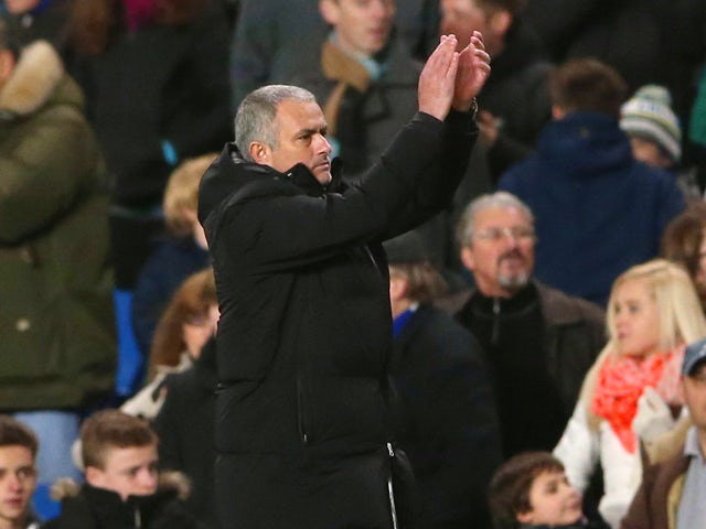 Jose Mourinho manager of Chelsea applauds the Crystal Palace fans at the final whistle during the Barclays Premier League match between Chelsea and Crystal Palace at Stamford Bridge on December 14, 2013