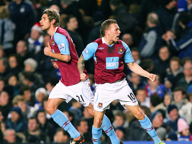 West Ham's Craig Bellamy celebrates with team mate Valon Behrami (L) after scoring the first goal of the match during their premiership match at home to Chelsea at Stamford Bridge football stadium on December 14, 2008