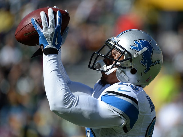Chris Houston #23 of the Detroit Lions warms up before the game against the Green Bay Packers at Lambeau Field on October 6, 2013