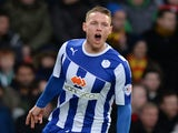 Connor Wickham of Sheffield Wedneday celebrates after scoring the opening goal from a free-kick during the Sky Bet Championship match against Watford on December 14, 2013