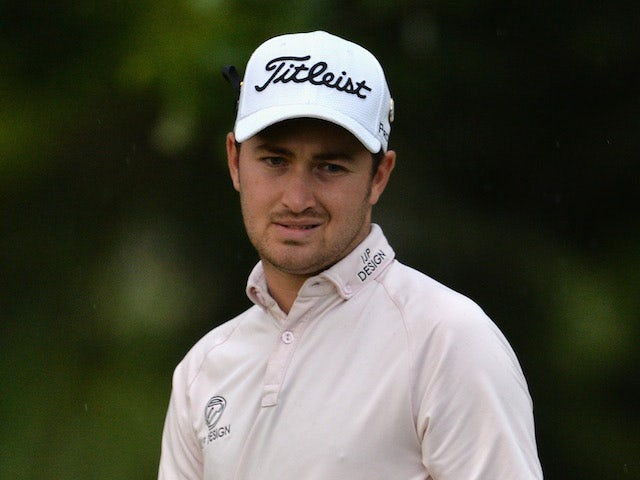 Daniel Brooks of England reacts to a shot during the first round of The Nelson Mandela Championship at Mount Edgecombe Country Club on December 11, 2013