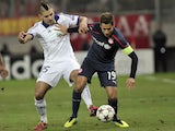 Olympiakos' David Fuster vies with Anderlecht's Alexander Mitrovic during an UEFA Champions League football match between Olympiakos and Anderlecht at the Karaiskaki stadium on December 10, 2013