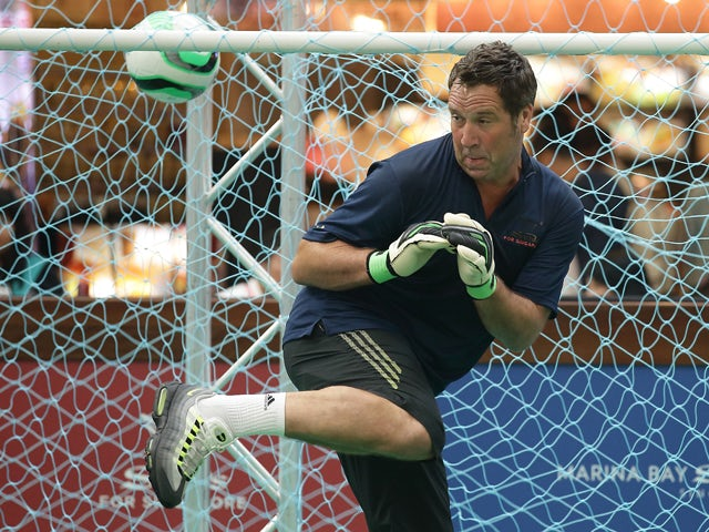 Former English football player, David Seaman reacts at goal in a football clinic with students from designated charities and local Singapore schools during the Sands for Singapore event at the Skating Rink at The Shoppes Marina Bay Sands on June 20, 2013