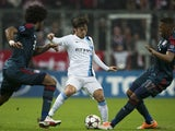 Manchester City's Spanish midfielder David Silva vies with Bayern Munich's defender Jerome Boateng (R) and Bayern Munich's Brazilian defender Dante during the UEFA Champions League Group D on December 10, 2013