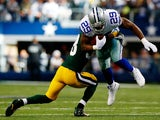 Running back DeMarco Murray of the Dallas Cowboys is tackled by cornerback Tramon Williams #38 of the Green Bay Packers during a game at AT&T Stadium on December 15, 2013
