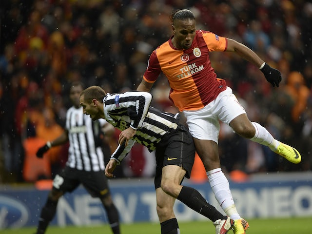 Galatasaray's Didier Drogba (R) vies with Juventus' Giorgio Chiellini (L) during an UEFA Champions League group B football match between Galatasaray and Juventus Turin on December 10, 2013