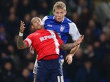 Blackburn Rovers striker DJ Campbell and Ipswich Town defender Christophe Berra tussle for the ball at Portman Road during a Championship match on December 3, 2013