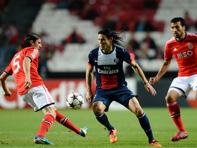 PSG's Uruguayan forward Edinson Cavani vies with Benfica's Serbian midfielder Ljubomir Fiesa and Argentinian defender Ezequiel Garay during the UEFA Champions League Group C match on December 10, 2013