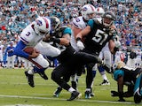 EJ Manuel of the Buffalo Bills crosses the goal line for a touchdown during the game against the Jacksonville Jaguars at EverBank Field on December 15, 2013