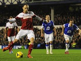 Dimitar Berbatov of Fulham scores his team's first goal from the penalty spot during the Barclays Premier League match between Everton and Fulham at Goodison Park on December 14, 2013