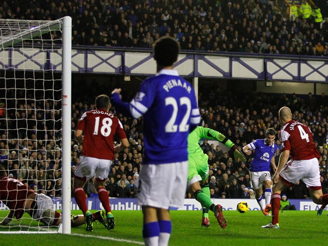Seamus Coleman of Everton scores his team's second goal during the Barclays Premier League match between Everton and Fulham at Goodison Park on December 14, 2013