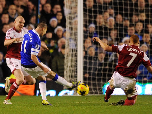 Kevin Mirallas of Everton scores his team's fourth goal during the Barclays Premier League match between Everton and Fulham at Goodison Park on December 14, 2013