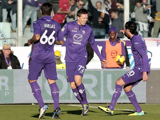 Josip Ilicic of ACF Fiorentina celebrates after scoring a goal during the Serie A match between ACF Fiorentina and Bologna FC at Stadio Artemio Franchi on December 15, 2013