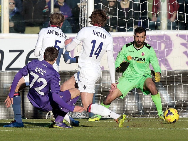 Josip Ilicic of ACF Fiorentina scores the opening goal during the Serie A match between ACF Fiorentina and Bologna FC at Stadio Artemio Franchi on December 15, 2013