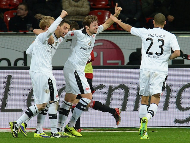 Frankfurt´s players celebrate during the German first division Bundesliga football match Bayer Leverkusen vs Eintracht Frankfurt in the German city of Leverkusen on December 15, 2013