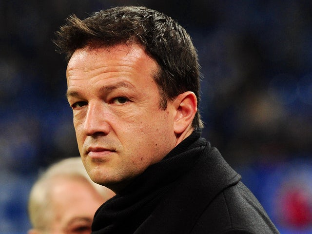 Stuttgart's Manager Fredi Bobic looks on prior to the German first division Bundesliga football match FC Schalke 04 vs VfB Stuttgart in the western German city of Gelsenkirchen on January 21, 2012
