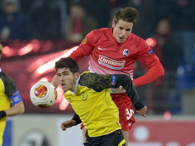 Freiburg's defender Christian Guenter and Sevilla's midfielder Jairo Samperio vie for the ball during the UEFA Europa League group H football match SC Freiburg vs Sevilla FC in Freiburg, southern Germany on December 12, 2013
