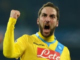 Napoli's Argentinian forward Gonzalo Higuain celebrates his goal during the UEFA Champion's League group F football match against Arsenal FC on December 11, 2013