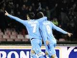 SSC Napoli's forward Gonzalo Higuain celebrates with his teammate Jose Maria Callejon after scoring during the Italian Serie A football match between SSC Napoli and Inter Milan on December 15, 2013