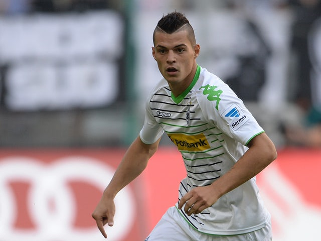 Moenchengladbach's Swiss midfielder Granit Xhaka plays the ball during the German first division Bundesliga football match Borussia Moenchengladbach vs Hanover 96 in the German city of Moenchengladbach on August 17, 2013