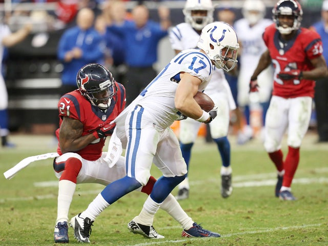 Griff Whalen #17 of the Indianapolis Colts is tackled by Brice McCain #21 of the Houston Texans on November 03, 2013