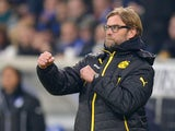 Dortmund's head coach Jurgen Klopp reacts as his team scores its 2nd goal during the German first division Bundesliga football match 1899 Hoffenheim vs Borussia Dortmund in Sinsheim, southwestern Germany, on December 14, 2013