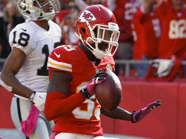Husain Abdullah of the Kansas City Chiefs scores a touchdown on an interception against the Oakland Raiders in the fourth quarter October 13, 2013