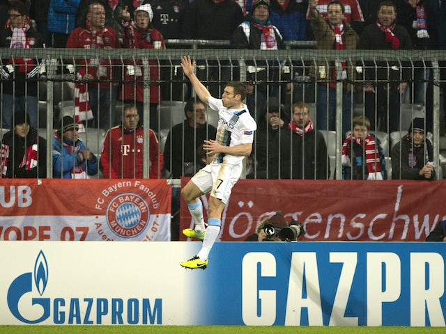 Manchester City's English midfielder James Milner celebrates after scoring during the UEFA Champions League group D football match Bayern Munich vs Manchester City on December 10, 2013