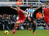 Southampton's English midfielder James Ward-Prowse (L) vies with Newcastle United's Dutch midfielder Vurnon Anita (R) during the English Premier League football match on December 14, 2013
