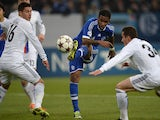 Schalke's Peruvian striker Jefferson Farfan, and Basel defenders Fabian Schaer and Taulan Xhaka vie for the ball during the UEFA Champions League group E match on December 11, 2013