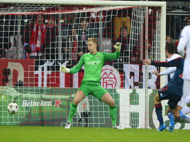 Manchester City's Joe Hart fails to save Bayern Munich's midfielder Thomas Mueller's goal during the UEFA Champions League group D football match on December 10, 2013