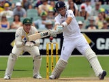 England's Joe Root plays a shot for a boundary as Australia's wicketkeeper Brad Haddin look on during the day four of the second Ashes cricket Test match against Australia in Adelaide on December 8, 2013