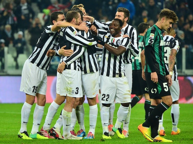Juventus' players celebrate after scoring a goal during the Serie A football match between Juventus and Sassuolo at the Juventus Stadium in Turin on December 15, 2013
