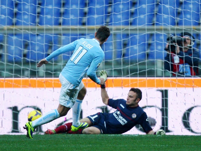 Miroslav Klose of SS lazio scores the second team's goal during the Serie A match between SS Lazio and AS Livorno at Stadio Olimpico on December 15, 2013