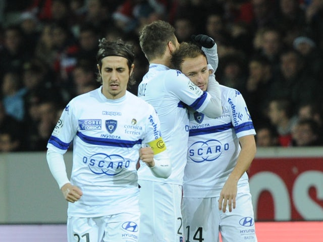 Bastia's French midfielder Ludovic Genest is congratulated by teammates after scoring during the French L1 football match Lille vs Bastia on December 15, 2013