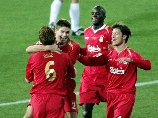 Liverpool's captian Steven Gerrard celebrates his goal with teammates John Arne Riise, Xabi Alongo and Momo Sissoko against Costa Rican club Deportivo Saprissa during their semi-final match in the World Club Championship in Yokohama, suburban Tokyo, 15 De