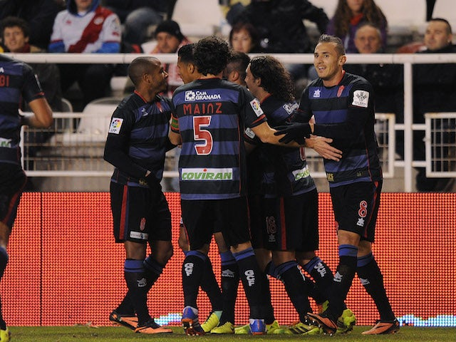 Mainz Garcia of Granada CF celebrates with Hassan Yebda (R) and team-mates after scoring the opening goal during the La Liga match against Rayo Vallecano de Madrid on December 14, 2013