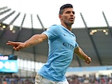 Sergio Aguero of Manchester City celebrates after scoring the opening goal during the Barclays Premier League match between Manchester City and Arsenal at Etihad Stadium on December 14, 2013