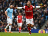 Arsenal's English midfielder Theo Walcott celebrates after scoring an equalising goal during the English Premier League football match between Manchester City and Arsenal at the Etihad Stadium in Manchester, northwest England, on December 14, 2013