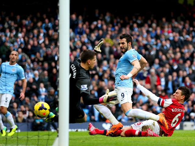 Laurent Koscielny of Arsenal fails to stop Alvaro Negredo of Manchester City scoring their second goal during the Barclays Premier League match between Manchester City and Arsenal at Etihad Stadium on December 14, 2013