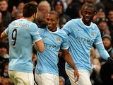 Manchester City's Brazilian midfielder Fernandinho celebrates scoring his team's third goal during the English Premier League football match between Manchester City and Arsenal at the Etihad Stadium in Manchester, northwest England, on December 14, 2013