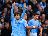 David Silva of Manchester City celebrates scoring their fourth goal during the Barclays Premier League match between Manchester City and Arsenal at Etihad Stadium on December 14, 2013